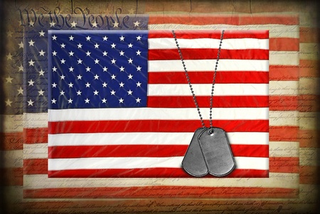 Military dog tags on American flag with textured overlay photo