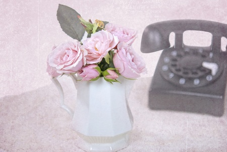 pink rose bouquet with old-fashioned phone Stock Photo