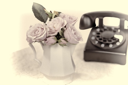 retro telephone with rose bouquet Stock Photo
