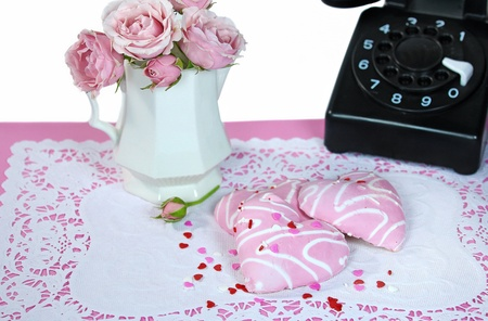heart sugar cookies with retro telephone and roses photo
