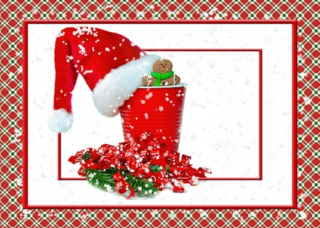 Santa hat on red party cup with gingerbread man photo