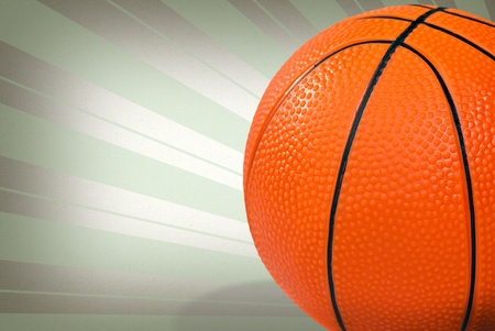 close up of a basketball on light beam background