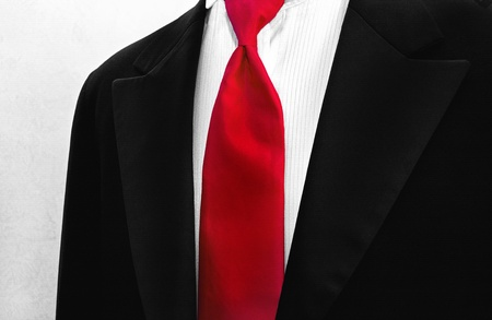 bold red tie accenting a tuxedo Stock Photo