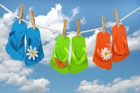 colorful flip-flops hanging on clothesline photo