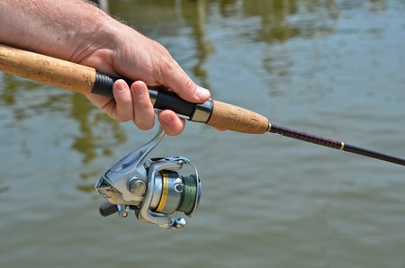 hand line fishing: man holding a fishing pole Stock Photo