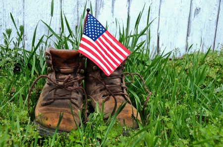 American flag in man s work boot photo