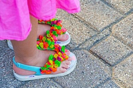 tied balloons on little girl s flip-flops photo