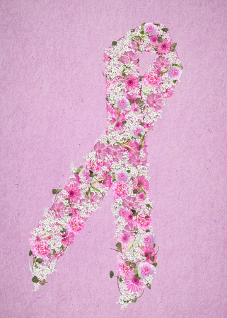 pink floral breast cancer awareness ribbon on pink