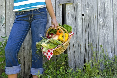 girl with basket of garden vegetables