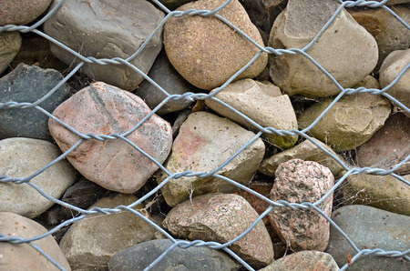 stone wall with wire fence