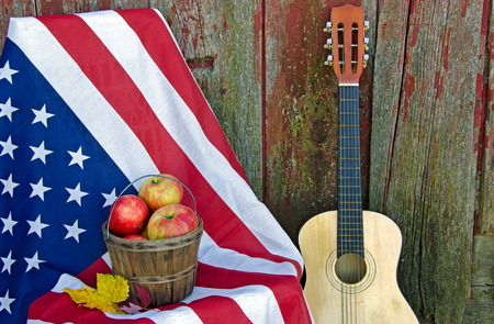 apple basket on flag with guitar by old barn photo