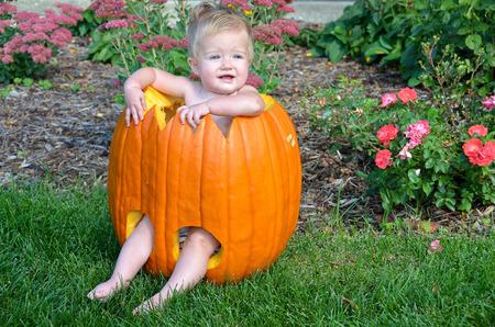 baby girl in Halloween pumpkin