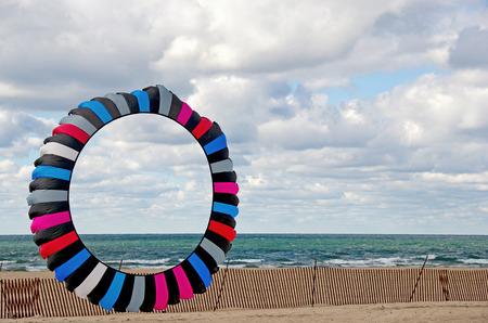 colorful circular kite on the beach Stock Photo