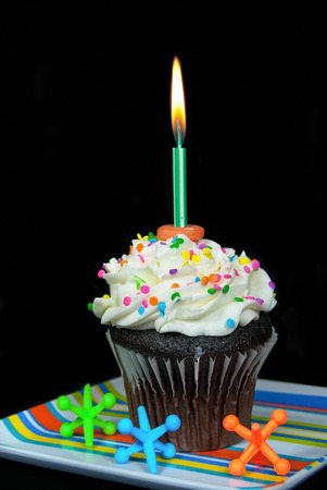 birthday candle in chocolate cupcake Stock Photo - 23322286