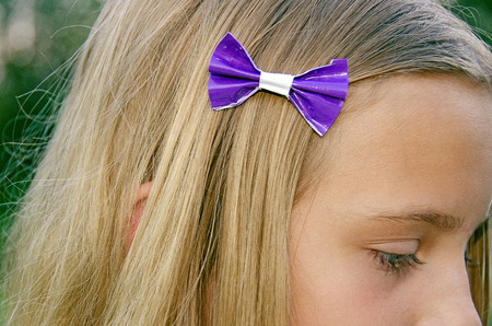 girl with duct tape bow in her hair