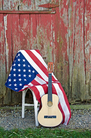 American flag with guitar by old red barn photo