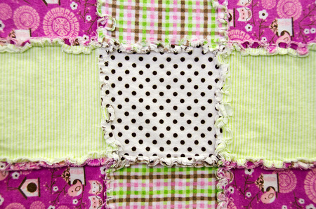 flannel: flannel patchwork quilt with frayed edge Stock Photo