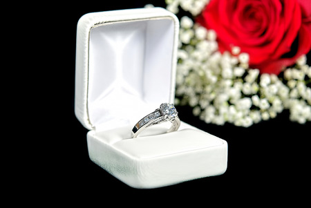 diamond ring in box with red rose