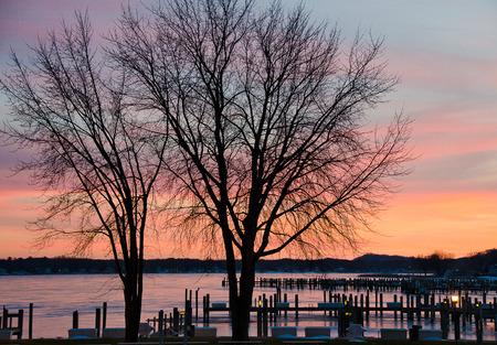 winter sunset over frozen marina