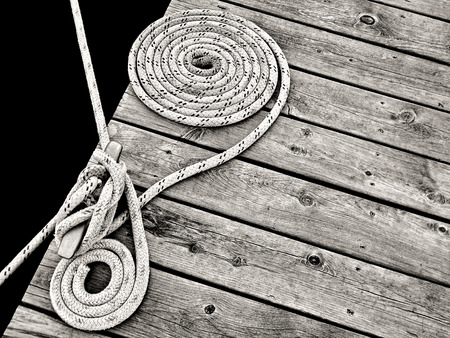 cleat: nautical rope secured to dock cleat Stock Photo