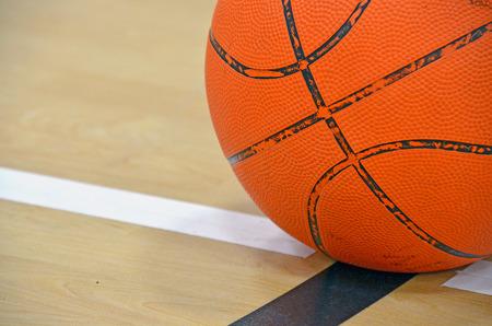 basketball on boundary line of basketball court Stock Photo