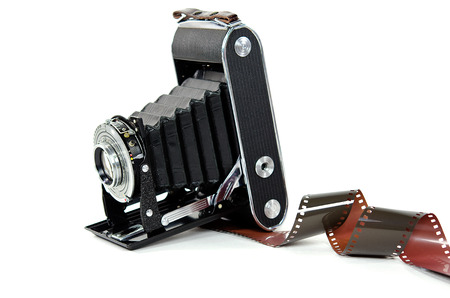 bellows: vintage bellows camera with filmstrip on white