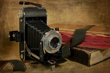 bellows camera with old books and film