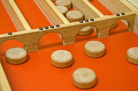 dutch: Dutch shuffleboard with wooden discs