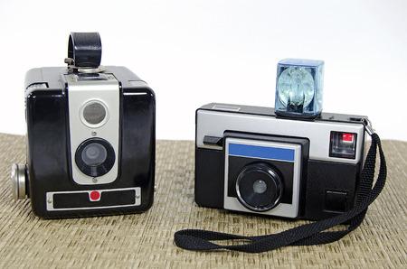 retro cameras on woven mat