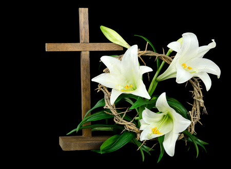 easter cross: Easter lilies with wooden cross and crown of thorns
