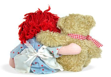 rag doll and teddy bear hugging