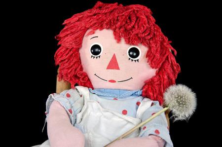 old rag doll with fluffy dandelion