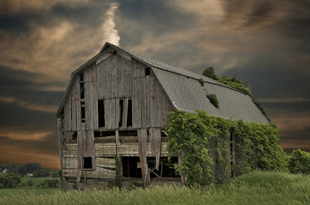 dilapidated: dilapidated old barn with sunset sky