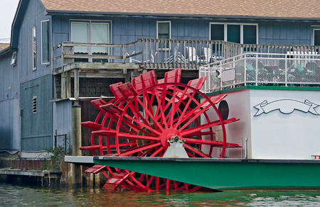 paddle wheel: red paddle wheel river boat