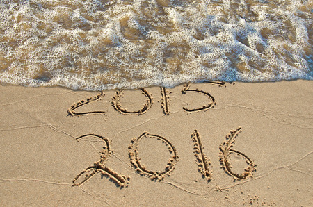 New Year 2016 in beach sand with surf