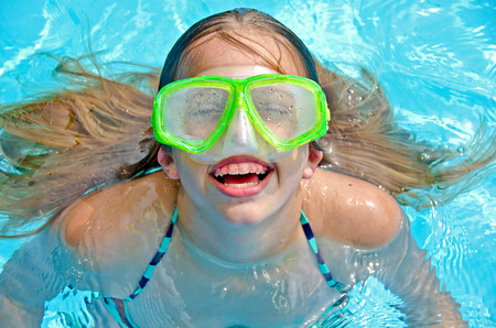 orthodontic: girl with swimming goggles  Stock Photo