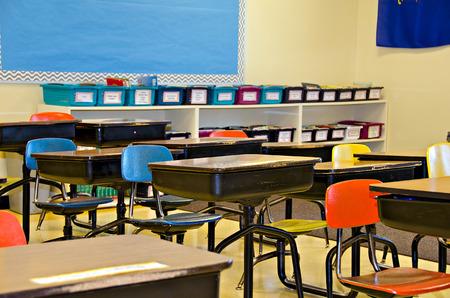 colorful school desks in elementary classroom