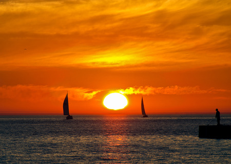 sailboat silhouettes on Lake Michigan photo