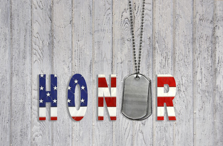 military dog tags with flag honor on weathered wood Standard-Bild