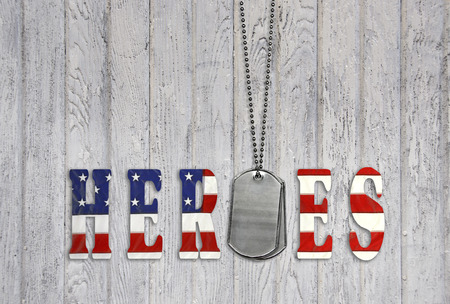veterans day: military dog tags with flag font for heroes on old wood