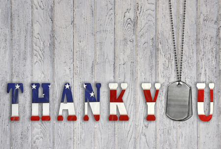 patriotism: military dog tags with patriotic flag thank  you on wood