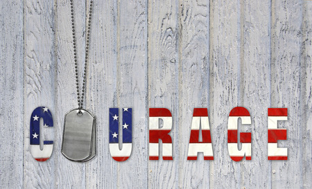military dog tags with flag courage on weathered wood