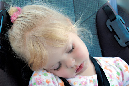 sleep: Caucasian little girl sleeping in car set with drool