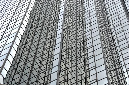 sky reflection: gray sky reflection in glass city skyscraper