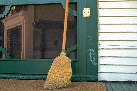 hobo: hobo sign with old broom  by green door Stock Photo