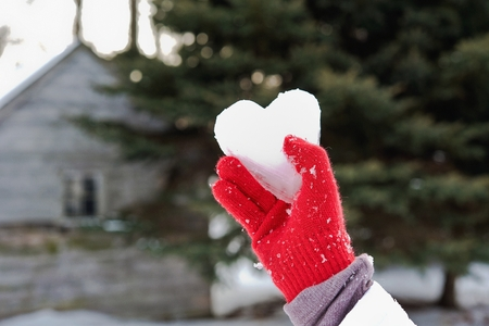wintry weather: ice heart in red glove Stock Photo