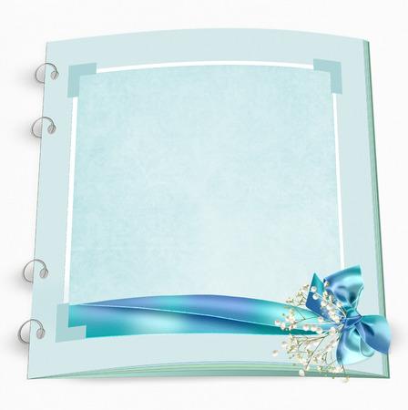 ribbon  and bouquet on bridal scrapbook album