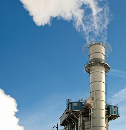 smokestack: factory smokestack with white smoke