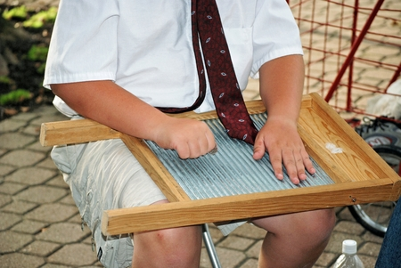 washboard: young boy playing a washboard with a quarter