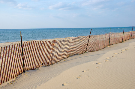 michigan snow: fence on vacant Lake Michigan beach